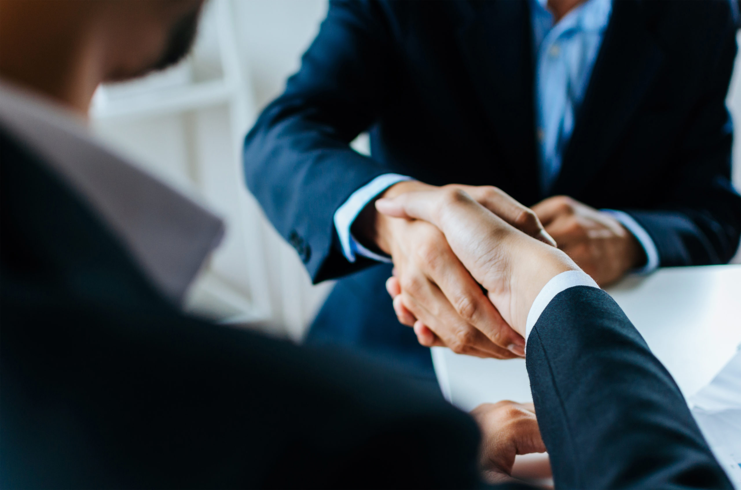 Startup business lawyer shaking hands with client