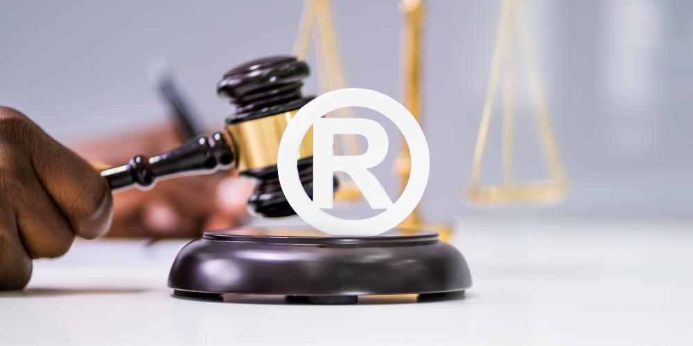 Trademark lawyer gavel with registered symbol